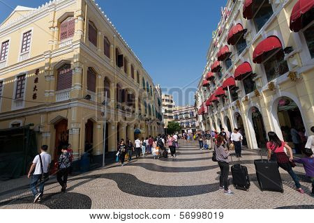 MACAU, CHINA - NOVEMBER 3, 2012: Tourists visit the Historic Center of Macau. Historic Center of Macau was inscribed on UNESCO World Heritage List in 2005.
