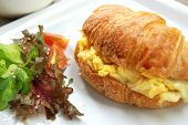 stock photo of scrambled eggs  - scrambled egg croissant sandwich good dish for morning