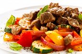 stock photo of veal meat  - Roasted meat and vegetables - JPG