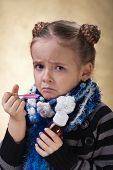stock photo of cough syrup  - Little girl does not like cough syrup or medicine - JPG