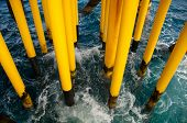 stock photo of offshoring  - Oil and Gas Producing Slots at Offshore Platform  - JPG