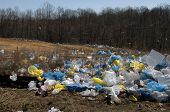 stock photo of landfill  - Plastic bags near a landfill in the US Virginia - JPG