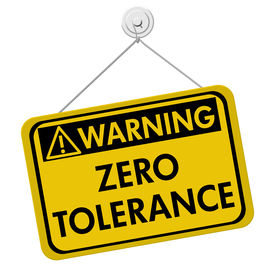 foto of zero  - Zero Tolerance Warning Sign A yellow and black sign with the words Zero Tolerance isolated on a white background - JPG