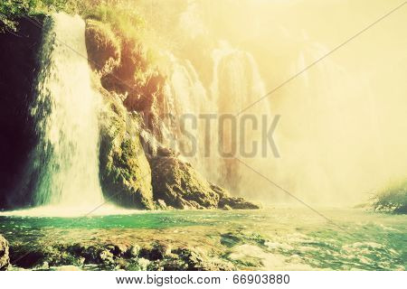 Waterfall in forest. Crystal clear water. Plitvice lakes, Croatia. Vintage, retro style