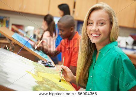 Female Pupil In High School Art Class