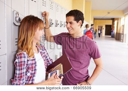 High School Students Standing By Lockers Talking