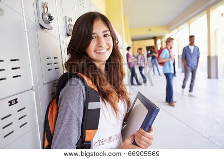Female High School Student Standing By Lockers