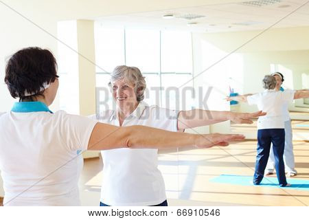 Portrait of sporty females doing physical exercise in sport gym