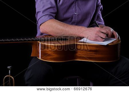Guitarist Writing A Song