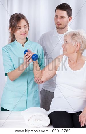 Elderly Woman Practicing During Rehabilitation