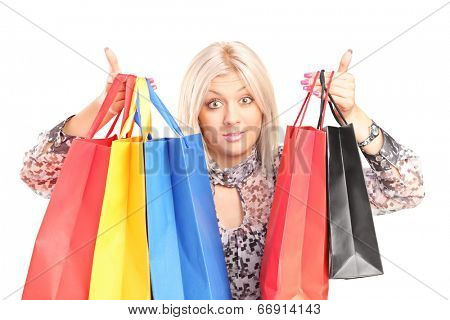 Surprised woman holding shopping bags isolated on white background
