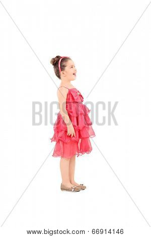 Profile shot of a cute kid in fancy dress looking up isolated on white background