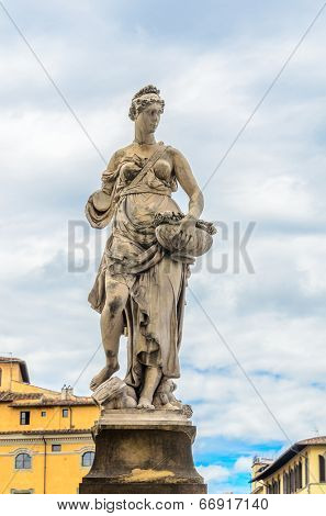 Florence, Statue sculpture at Ponte alla Carraia medieval Bridge landmark on Arno river.