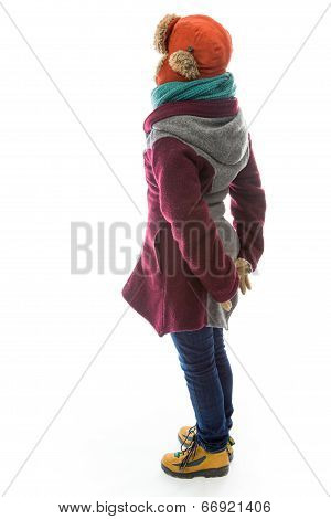 Side profile of a young woman in warm clothing and standing