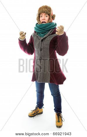 Frustrated young woman in warm clothing