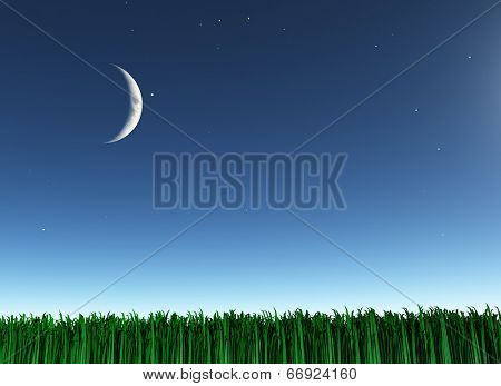 Moon over green landscape