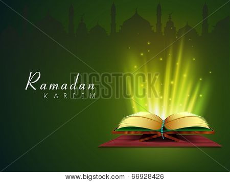 Holy illumination coming out from Islamic religious book Quran Shareef on green background for Ramadan Kareem.