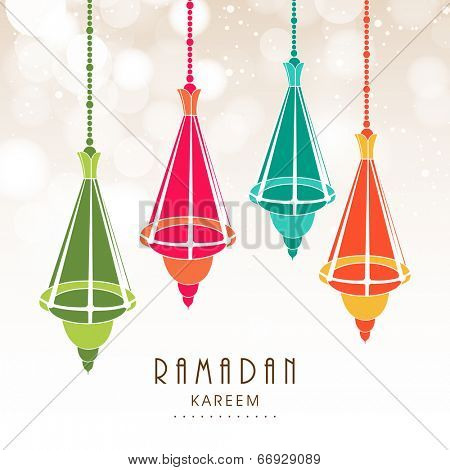 Colorful hanging decorative on shiny brown background for holy month of Muslim community Ramadan Kareem.