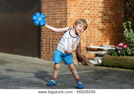 Active Little Boy Playing With Ball Toy