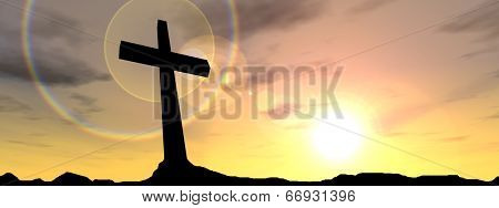 Concept conceptual black cross or religion symbol silhouette in rock landscape over a sunset or sunrise sky with sunlight clouds banner background