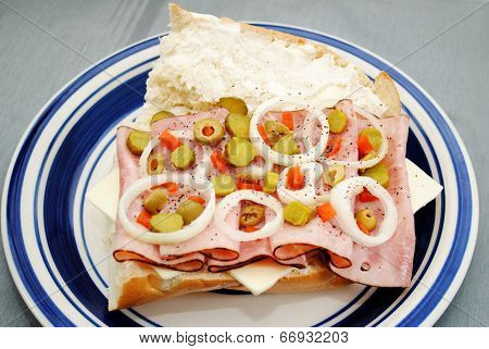 Vegetables On Top Of A Ham And Cheese Sandwich