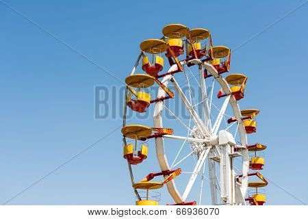 People Riding Giant Ferris Wheel