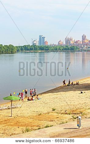 Unidentified People Are Resting On The Beach Of Dnipr River In Obolon district, Kyiv