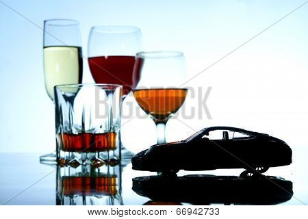 Alcoholic Drink and a toy car