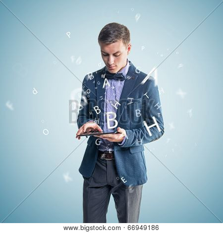 Handsome businessman text message email sms on mobile phone tablet