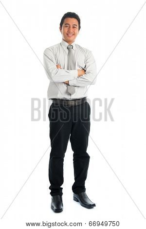 Full body of handsome Asian young male in casual business attire, smiling confidently with arms crossed, standing isolated on white background.
