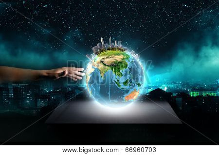 Close up of human hand touching Earth planet with finger. Elements of this image are furnished by NASA