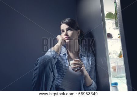 Sleepless Woman Having A Glass Of Milk