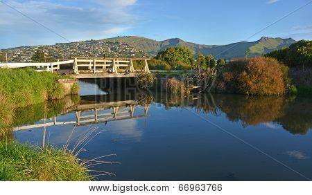 Black Heron Fishing On A Heathcote River Bridge
