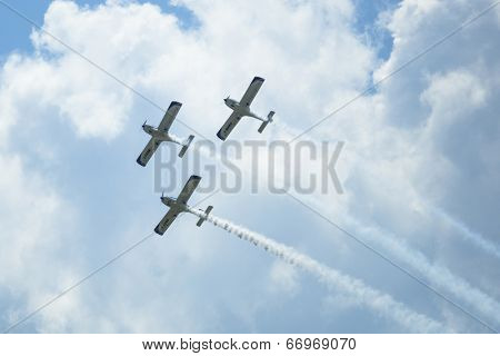 BERLIN, GERMANY - MAY 20, 2014: Aerobatic team 3x Fly Sinthesis Texan Top Class (Wefly team, Italy) demonstration during the International Aerospace Exhibition ILA Berlin Air Show-2014.
