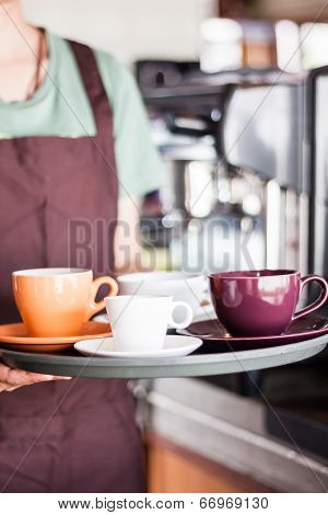 Barista Serving Set Of Freshly Brewed Coffee