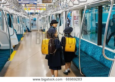 Japanese Students on a Train