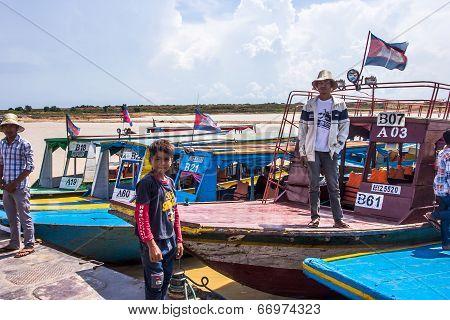 Siem Reap, Cambodia - May 3: Cambodian Men Wait The Tourist For Visiting Tonle Sap Lake In Siem Reap