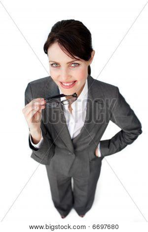 Self-assured Businesswoman Holding Glasses