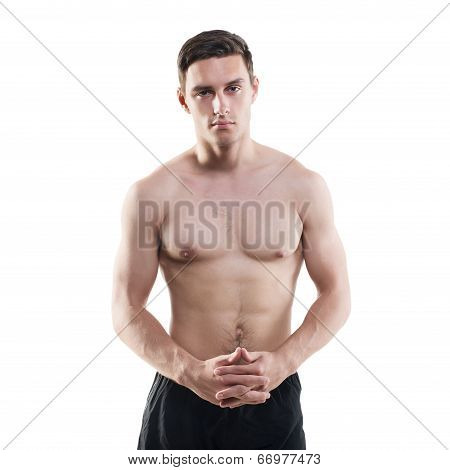 Portrait of an attractive athlete sportsman muscular handsome sexy guy in sport dress, strong man, n