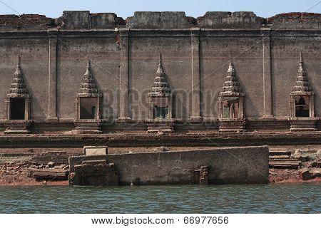 Old Buddha In Ancient Temple Or Church Walls Sangklaburi