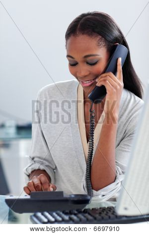 Assertive Ethnic Businesswoman Talking On A Phone