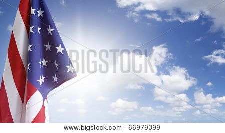 American flag in blue sky
