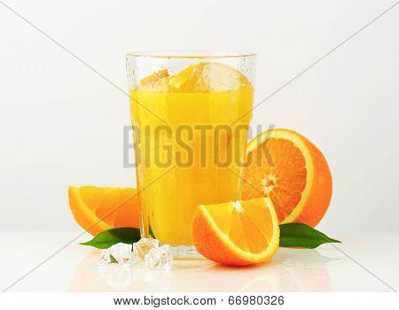 glass of refreshing orange juice with ice