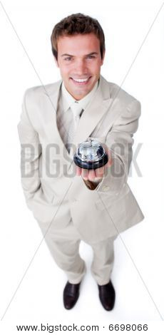 Assertive Young Businessman Holding A Service Bell