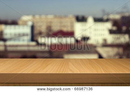 Wooden Table Over Outdoor City Blur Background