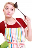 stock photo of ladle  - Funny housewife or cook chef in colorful kitchen apron with ladle isolated studio shot - JPG