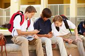 stock photo of playground school  - Male High School Students Using Mobile Phones On School Campus - JPG