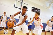 picture of 16 year old  - Male High School Basketball Team Playing Game - JPG