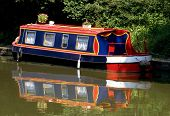 stock photo of houseboats  - Houseboat moored beside a canal tow path - JPG