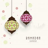 stock photo of ramadan kareem  - Stylish hanging arabic lanterns on mosque silhouetted colorful abstract background for holy month of Muslim community Ramadan Kareem - JPG